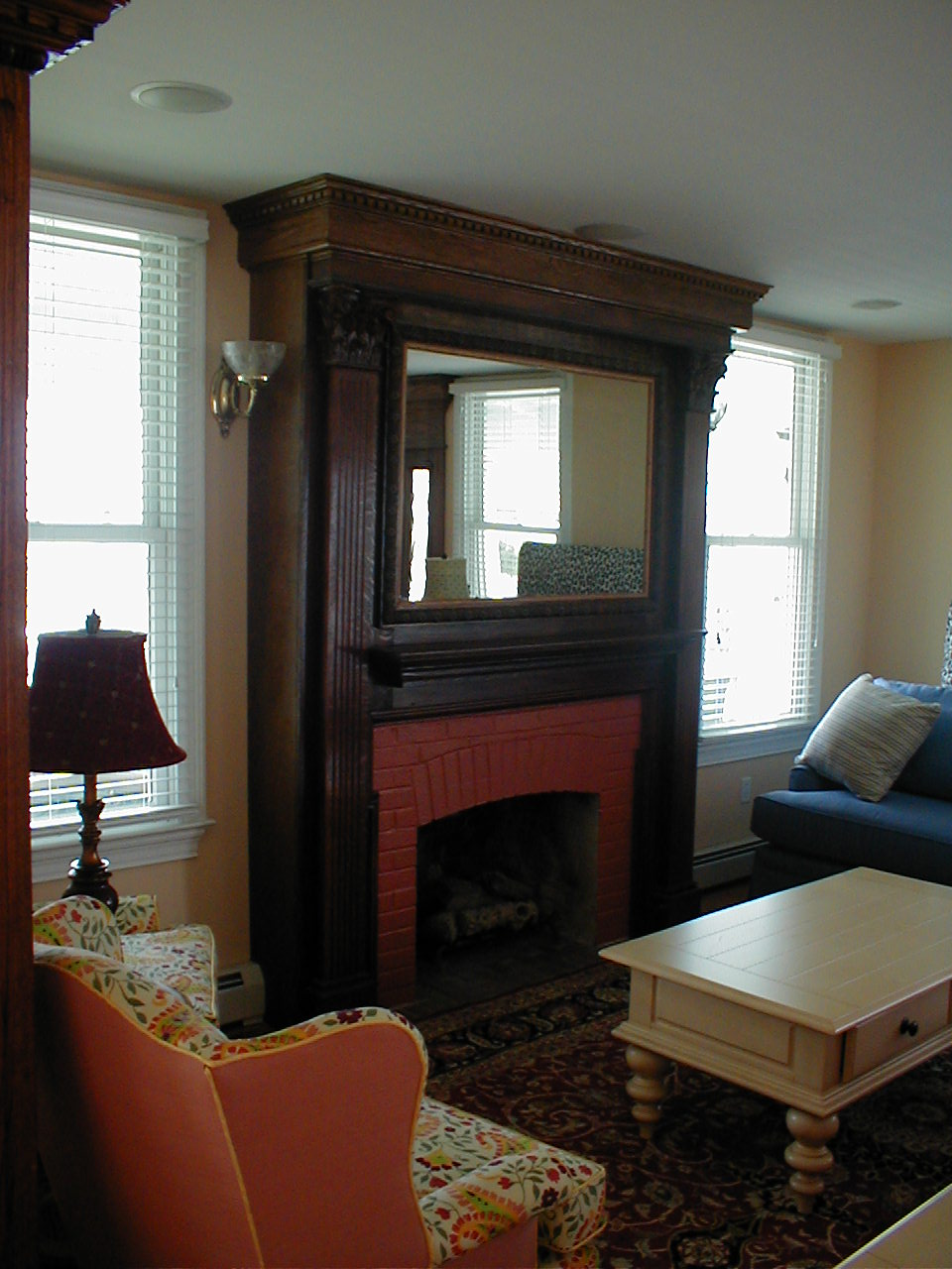 Stained Mantle: Design Built Victorian Mantle out of Salvage Chestnut Wood, Stained in Old Word Color. Installed Plasma TV behind Two Way Mirror for TV Watching without Losing Elegance of Mantle.